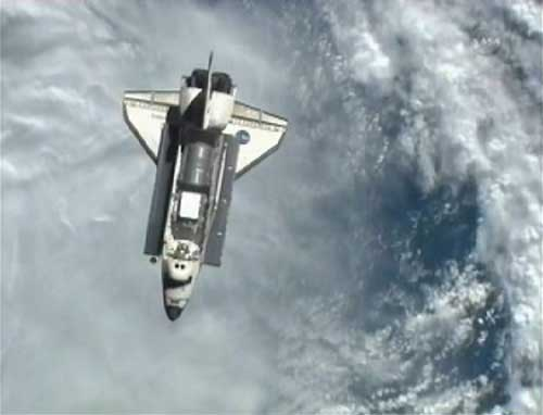 U.S. space shuttle Discovery arrives at space station