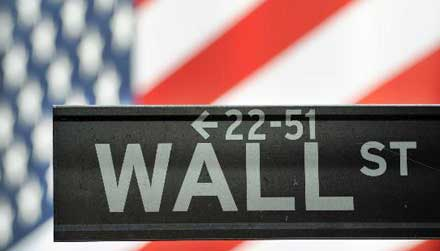 Wall Street falls with S&P 500, Nasdaq erasing 2011 gains