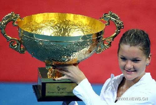 Radwanska survives 154-minute battle to lift China Open title