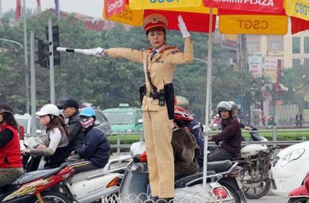 Vietnam, Hanoi, traffic policewomen, intersection