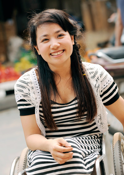 Nguyen Thi Hau, 29, from Ha Nam, is a student at the Hanoi Medical College and the owner of a small tailor's shop.