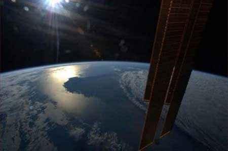 Canadian ISS astronaut returns to Earth a star