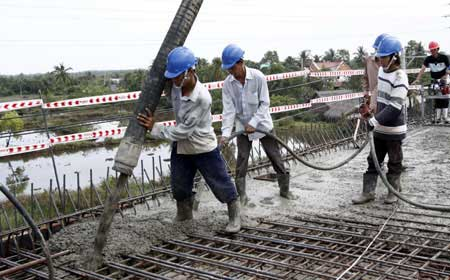 Workers at a highway construction site in HCM City. Construction is among the sectors with high human resource demands in the city. Unskilled and semi-skilled workers account for 48 per cent of total demand.