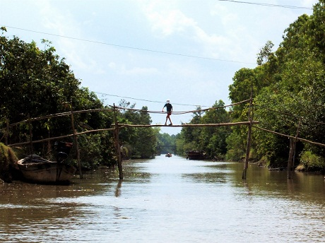 A monkey bridge.  Almost all countries have characterized bridges. The bridges reflect the lifestyle and customs of the local people. There are extremely odd bridges that many tourists feel very scared when they pass them, like playing a risky game.