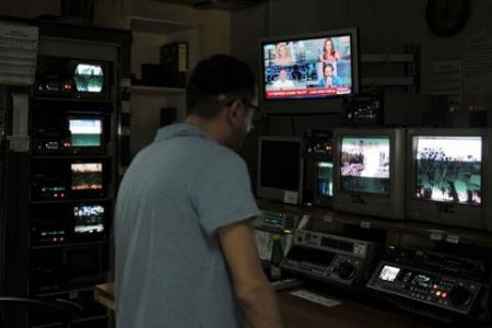 An employee works in an ERT broadcasting room on June 11, 2013. Greece's public TV and radio channels were off the air Wednesday after a shock decision by the government to shut down the state broadcaster's operations with immediate effect, a move affecting nearly 2,700 jobs.