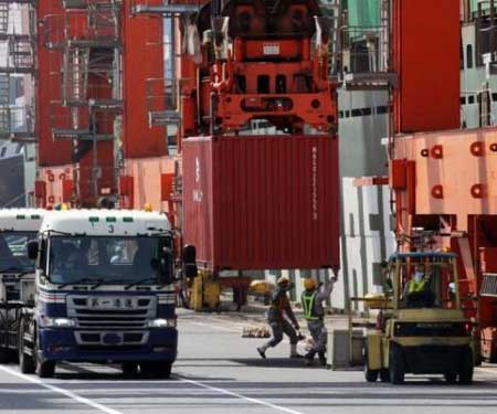 Containers are unloaded from an international freighter onto trucks at the international cargo terminal in Tokyo, on May 22, 2013. Japan extended a string of trade deficits in May, according to official data, as the country's import costs rose on the weak yen, but shipments to the United States and China soared.