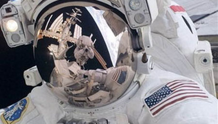 NASA aborts spacewalk after water leak inside astronaut's helmet