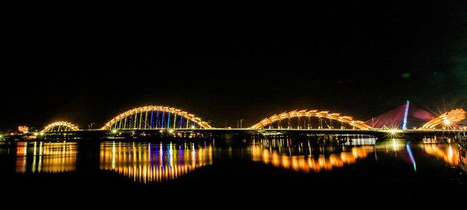 The fanciful Dragon Bridge at night.
