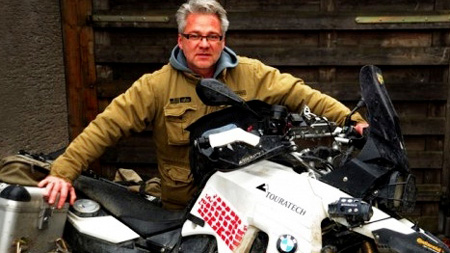 german journalist makes charity visit to central vietnam by motorcycle