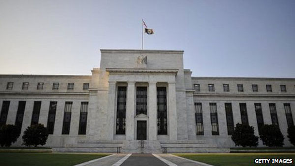 US central bank cuts growth forecast for 2014