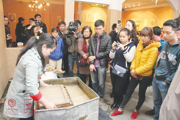 Young woman's social enterprise revitalises do paper-making trade