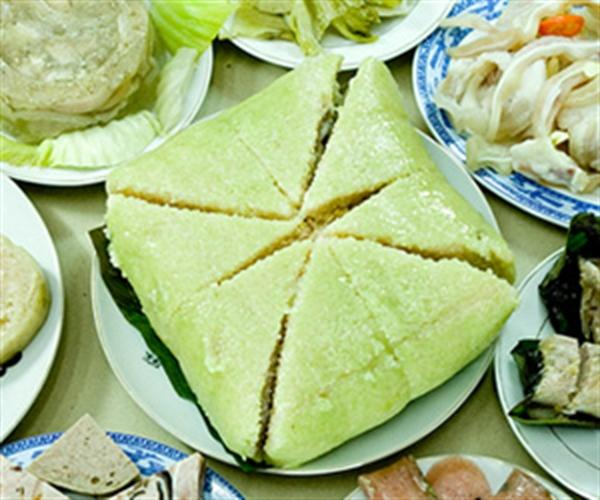 "Banh Chung"" (square glutinous rice cake) is a traditional cake of ..."