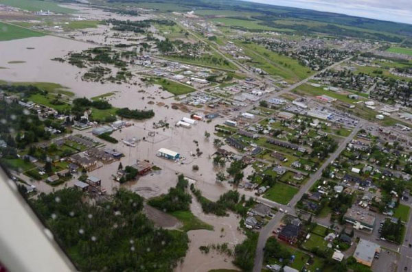 Flooded Canadian towns in gas heartland declare state of emergency