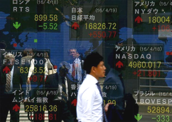 Asian shares surge, dollar lags on slow-motion Fed