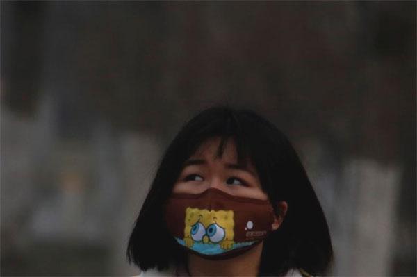 Smog-hit Beijing slapped with top 'fog' alert for second day