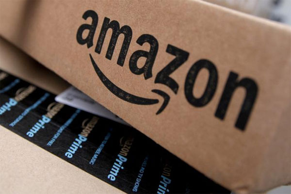 Amazon sees lower operating profit this quarter, shares dip