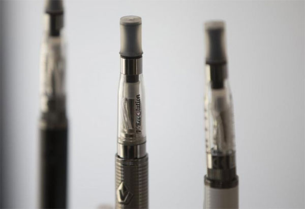 Cancer-causing toxins, e-cigarettes, safer