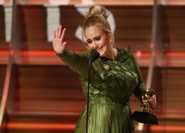 Adele sweeps Grammy awards in upset victory over Beyonce