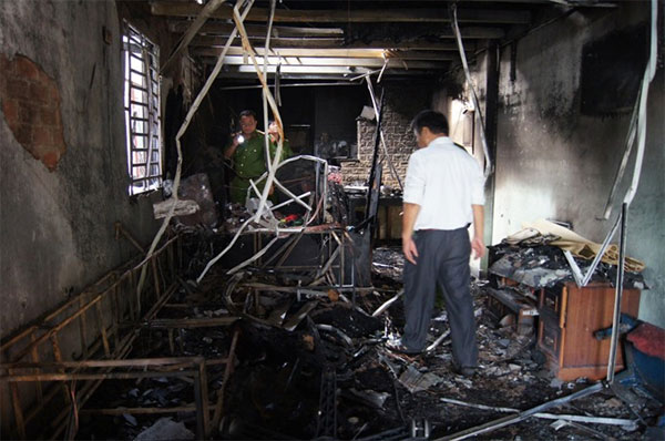 A house caught fire in Binh Duong Province's Thu Dau Mot City yesterday, killing a young couple and their two children.