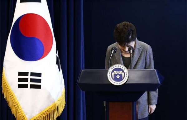 South Korean court throws president out of office, two dead in protest