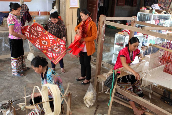 Thai women weaving the fabric of cultural identity, entertainment events, entertainment news, entertainment activities, what's on, Vietnam culture, Vietnam tradition, vn news, Vietnam beauty, news Vietnam, Vietnam news, Vietnam net news, vietnamnet news,