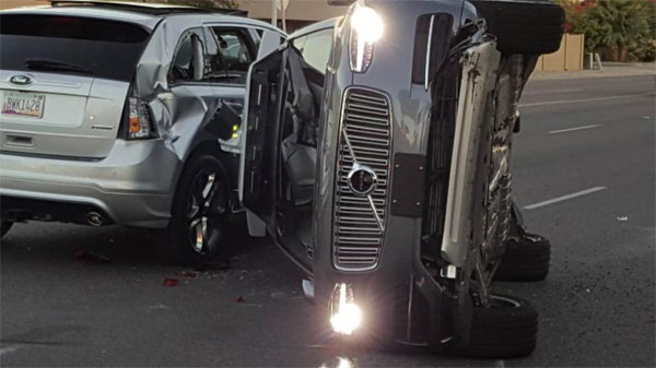Uber suspends self-driving car program after Arizona crash