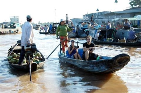 Foreign tourists visit Cai Rang floating market in the Mekong Delta province of Can Tho.