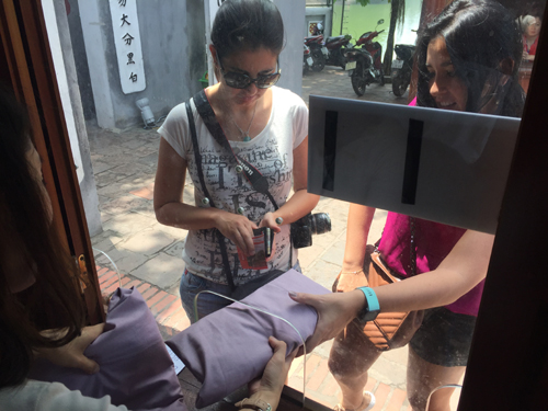 Hanoi's famous temple applies dress code to visitors