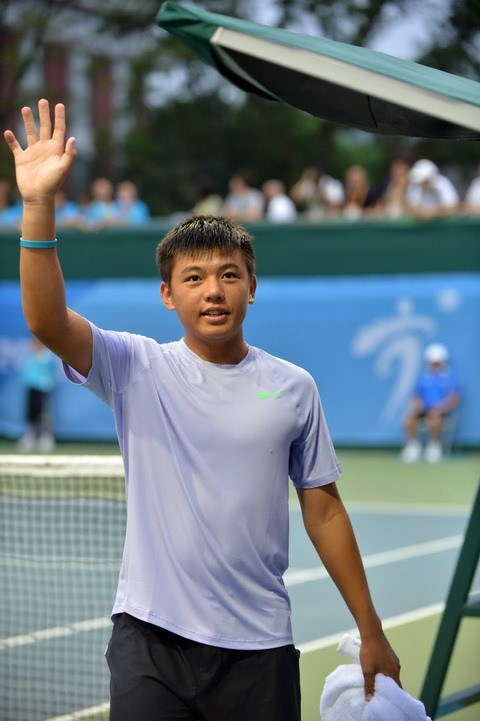 Ly Hoang Nam through to Singapore tennis event's second round