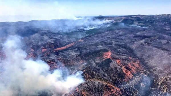 Utah wildfire levels 13 homes, forces evacuation of 1,500 people