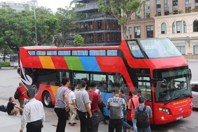 Double-decker tourist bus starts trial run in Hanoi