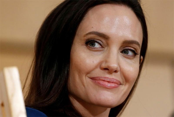 Angelina Jolie puts movies aside for cooking, cleaning up poop