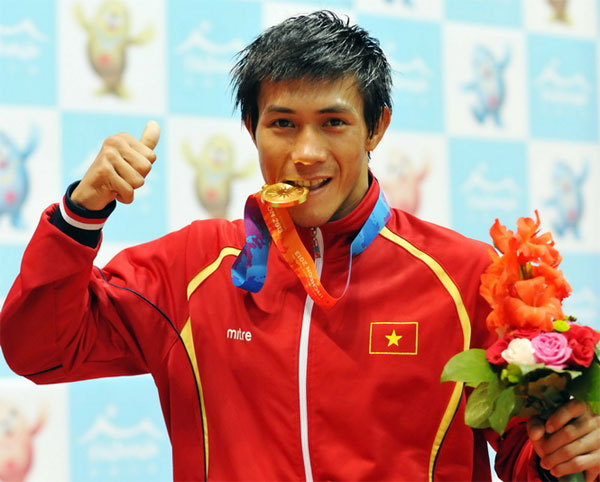 Athlete seeks to kick, punch his way to gold