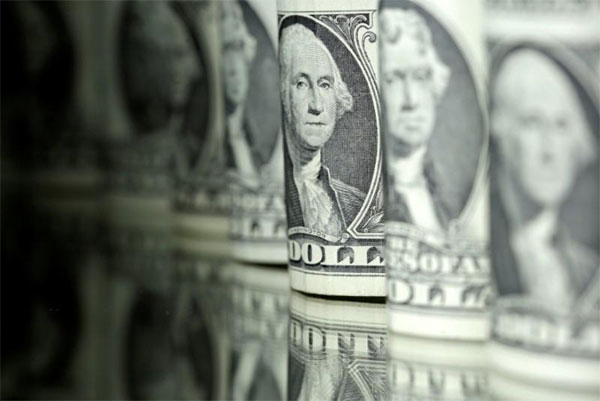 Dollar holds firm before Fed minutes, stocks rise
