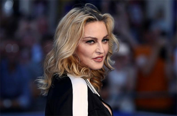 Madonna, moves to Portugal, newly-fashionable city, rated new star