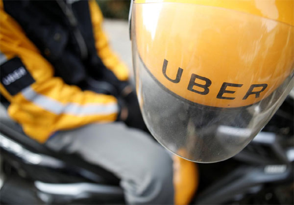 Uber, reviews Asia business, bribery allegations