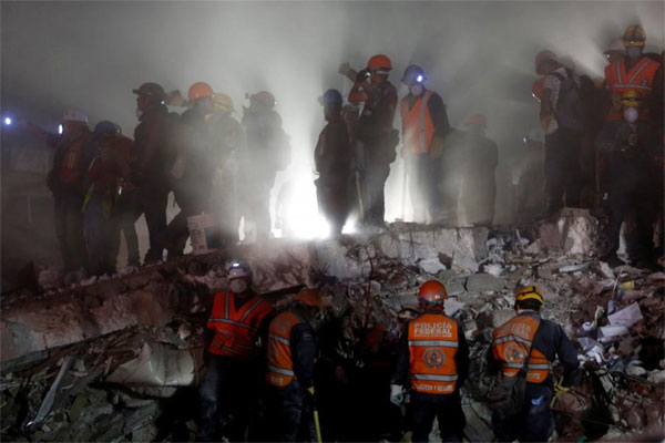 Mexico rescuers work into night to save trapped girl as quake toll tops 230