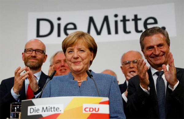 Chastened Merkel braces for coalition tussle after vote