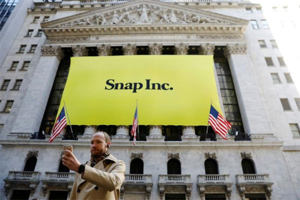 France, Snapchat messaging app, Discover news feature, users
