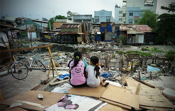 HCM City, relocate slum dwellers, low-income housing, Vietnam economy, Vietnamnet bridge, English news about Vietnam, Vietnam news, news about Vietnam, English news, Vietnamnet news, latest news on Vietnam, Vietnam