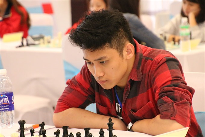 Thang wins first match at chess, Minh draws
