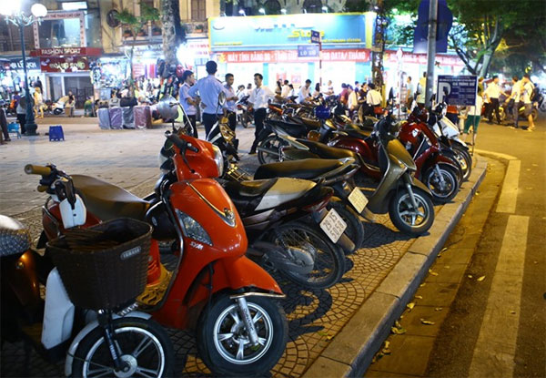 On-street parking damages pavements in Hanoi