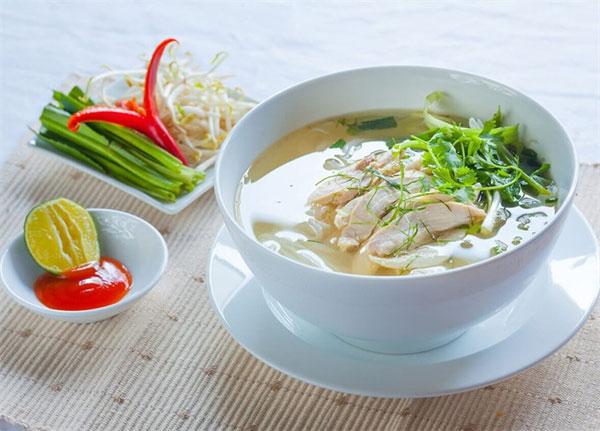 Traditional Vietnamese dish of noodles, pho ga, pho bo, Vietnam economy,  Vietnamnet