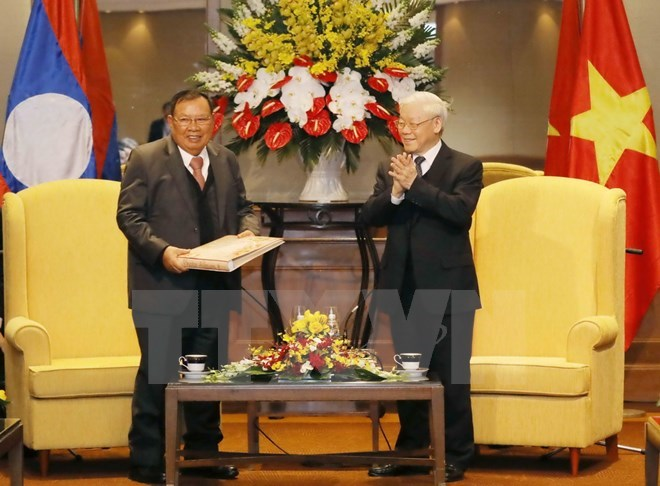 Lao top leader concludes official friendly visit to Vietnam, Government news, Vietnam breaking news, politic news, vietnamnet bridge, english news, Vietnam news, news Vietnam, vietnamnet news, Vietnam net news, Vietnam latest news, vn news