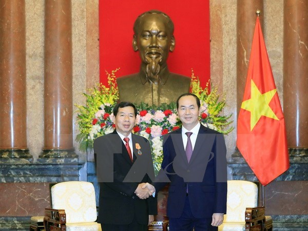 President Tran Dai Quang receives Lao supreme court chief, Government news, Vietnam breaking news, politic news, vietnamnet bridge, english news, Vietnam news, news Vietnam, vietnamnet news, Vietnam net news, Vietnam latest news, vn news