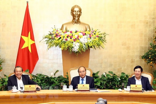 PM urges prompt resumption of work following Tet holiday