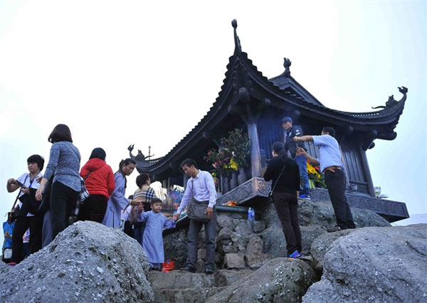 Standing at heaven's gate on Bao Dai Mountain
