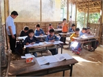 Mixed aged pupils share classroom in mountainous area