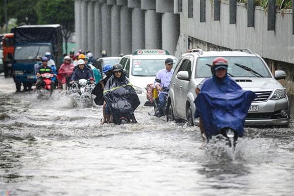 HCM City, combat floods, flood-prone spots, Vietnam economy, Vietnamnet bridge, English news about Vietnam, Vietnam news, news about Vietnam, English news, Vietnamnet news, latest news on Vietnam, Vietnam