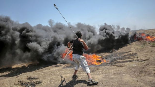 Gaza, Israeli troops, fire, Palestinian protesters, deadliest day of violence